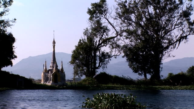 Pagoda at Inle Lake HDV226 A golden pagoda at Inle Lake, Myanmar shallow stock videos & royalty-free footage