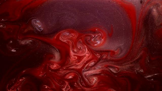 paint mix motion mystiska skimmer rött bläck flöde - akrylmålning bildbanksvideor och videomaterial från bakom kulisserna