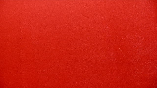 paint roller 2 painter rolls red paint onto a white wall brightly lit stock videos & royalty-free footage