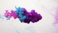 istock paint shot water blue pink purple smoke cloud 1189534740