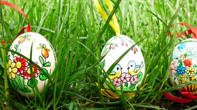 Painted Easter eggs in the grass. Panning. video