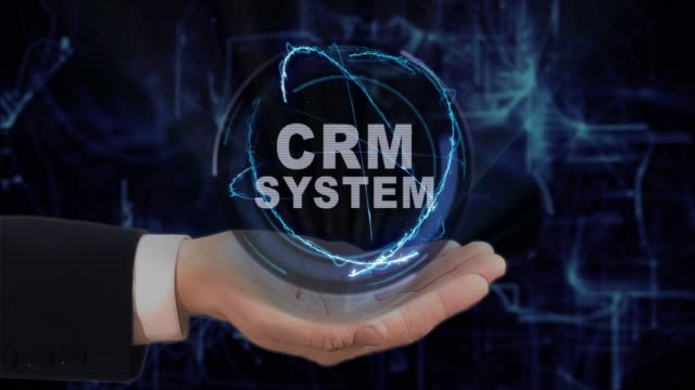 Painted hand shows concept hologram CRM system on his hand