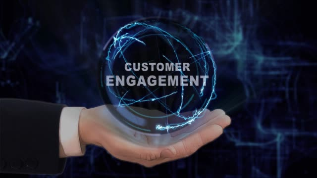 Painted hand shows concept hologram Customer engagement on his hand video