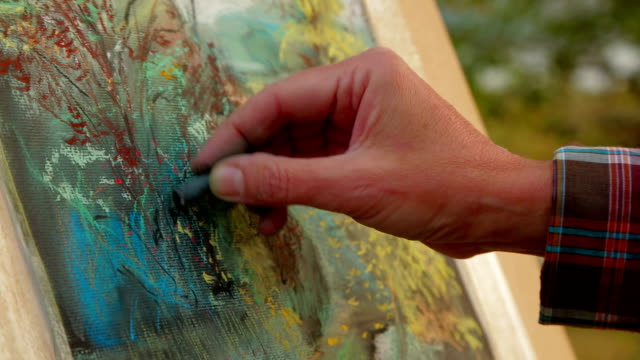Painter Drawing A Picture of Autumn Landscape.  Close-up. video