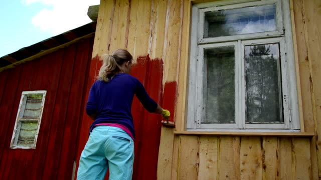 painter woman brush wall video