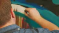 istock Painter working in his studio 1218055928