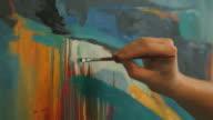istock Painter working in his studio 1218060213