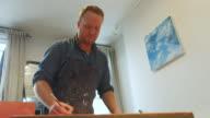 istock Painter working in his studio 1218209146