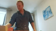 istock Painter working in his studio 1218220149