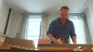 istock Painter working in his studio 1218240960