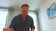 istock Painter working in his studio 1218247687