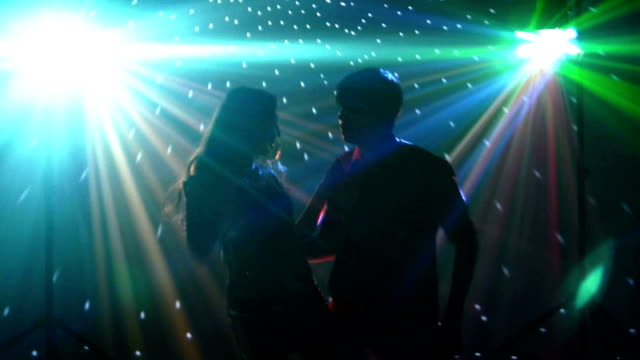 pair dancers dancing in spotlight at the club, silhouette - prom fashion stock videos and b-roll footage