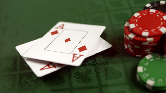 HD SLOW MOTION: Pair Of Aces Falling On A Table video