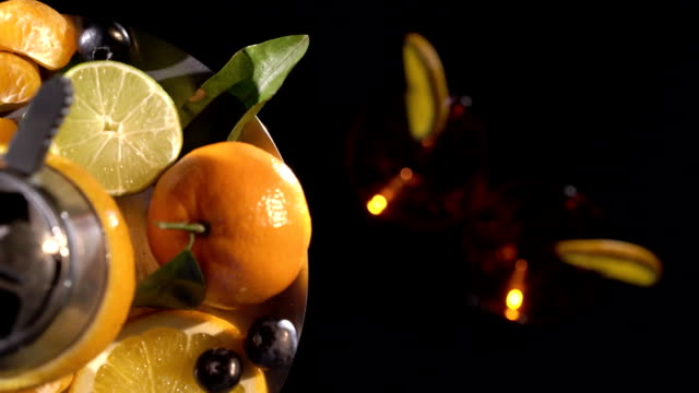 Pair of glasses with alcoholic drink beverage wine and hookah with fruits video