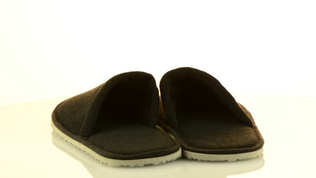 A pair of grey slippers video