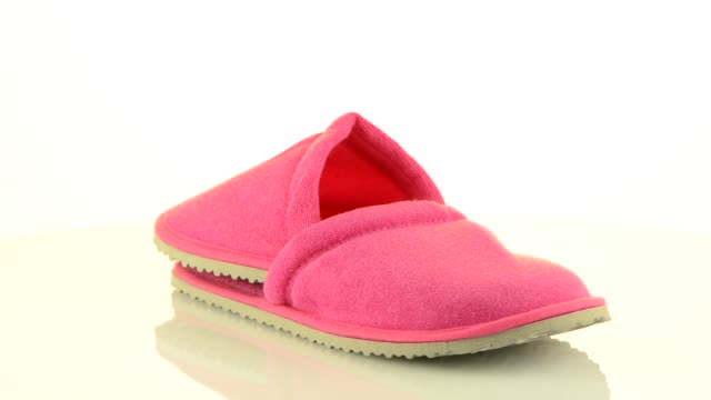 A pair of pink slippers video