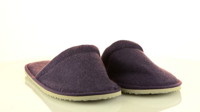 A pair of purple slippers video