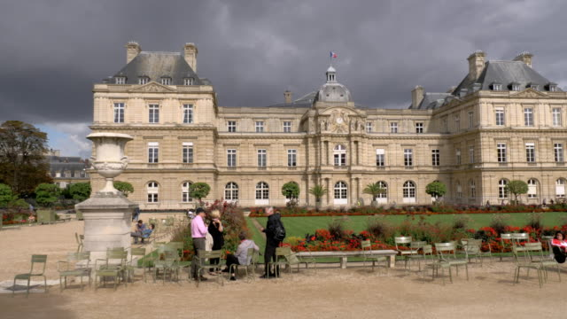 palace in luxembourg gardens with visitors relaxing outdoor, paris - french architecture stock videos & royalty-free footage