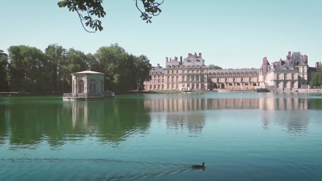 Palace of Fontainebleau in summer - France Palace of Fontainebleau from the carp pond, in the public park. palace stock videos & royalty-free footage