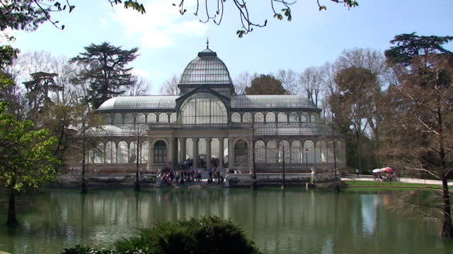 Palacio De Cristal – Madrid, Spain The Palacio de Cristal (Crystal Palace) in the Parque del Retiro, Madrid, Spain. wrought iron stock videos & royalty-free footage