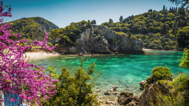 Paleokastritsa bay on Corfu island, Greece Paleokastritsa bay with its turquoise water on Corfu Island in Greece. Paleokastritsa is a famous village surrounded by idyllic bays and rocky coastlines at the west coast of Corfu. greek islands stock videos & royalty-free footage