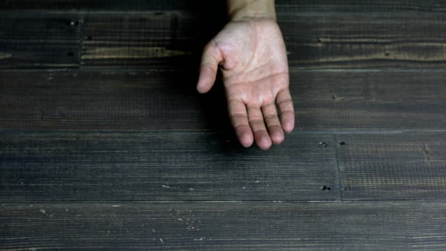 palm of a hand on wooden background - palm of hand stock videos & royalty-free footage