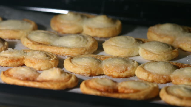 palmiers in the oven, macro shot - french food stock videos and b-roll footage