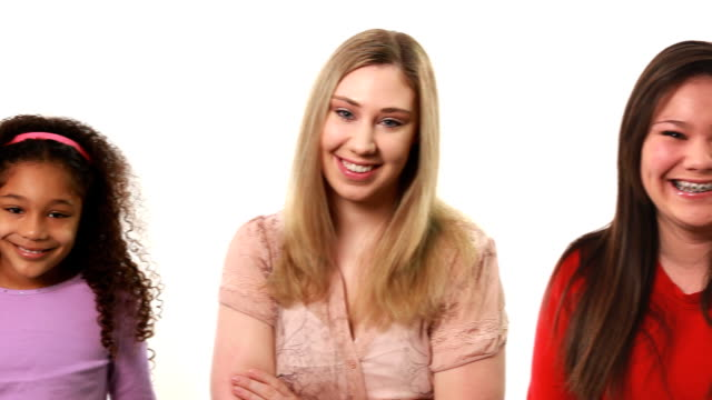 Pan across variety of people on white background video
