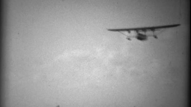 1935: Pan Am Sikorsky S-40 sesquiplane amphibious flying boat landing to crowd. video