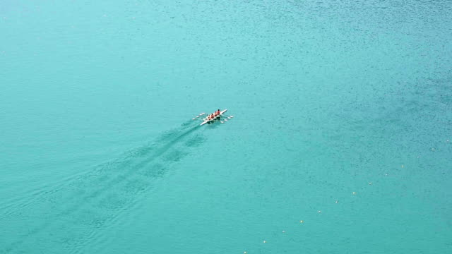 HD LR Pan: Four-seated scull rowing team practicing video