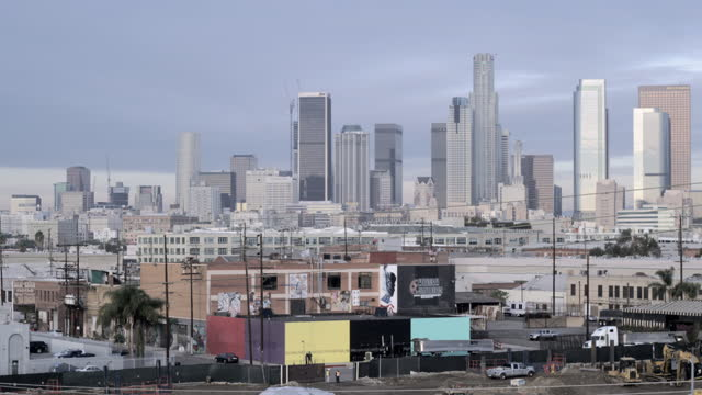 Pan from approaching train to Downtown Los Angeles HD video