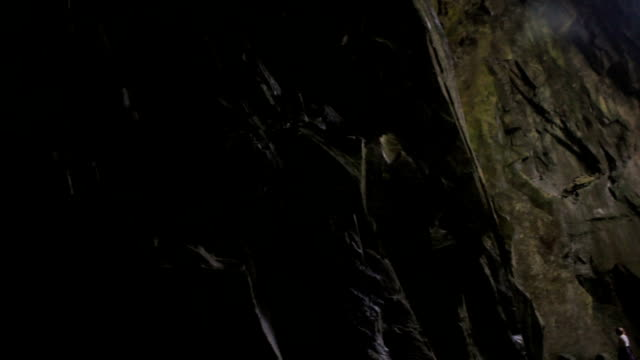 Pan from darkness to light in an amazing cave video