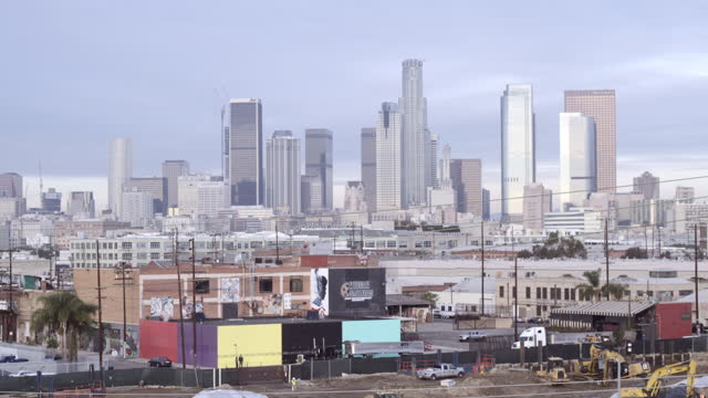 Pan from traffic on bridge to Downtown Los Angeles HD video