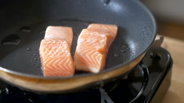 pan fry salmon fillet chef using fry pan cooking salmon fillet seared stock videos & royalty-free footage