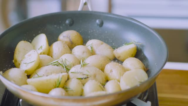 pan frying baby potato front view of frying baby potato at home kitchen prepared potato stock videos & royalty-free footage