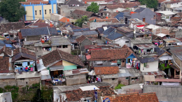 Pan of a crowded slum in Indonesia video