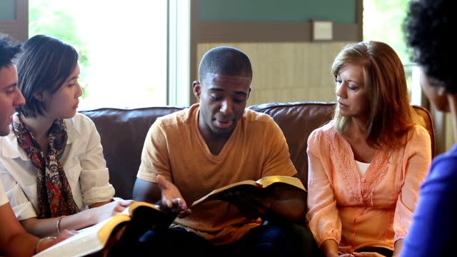 Pan of Bible Study Group discussing scripture together video