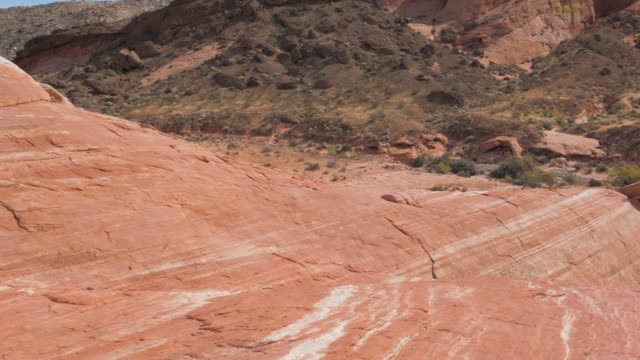 pan of desert rocks and cliffs in red rock canyon national reserve slow motion - red rock canyon national conservation area video stock e b–roll
