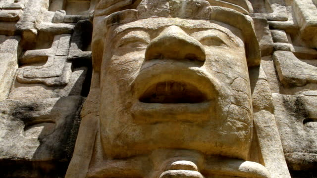 """Pan of Mayan Temple Pan of a face on a Mayan Temple in Lamanai (""""submerged crocodile"""") in Belize old ruin stock videos & royalty-free footage"""