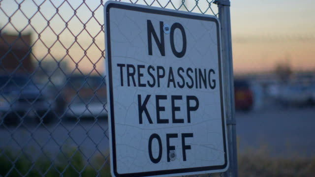 Pan of No Trespassing Keep Off Sign