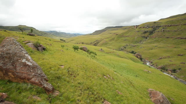 Pan of the Drakensberg Valley A pan shot of a lush green valley in the Drakensberg in KwaZulu-Natal . natal stock videos & royalty-free footage