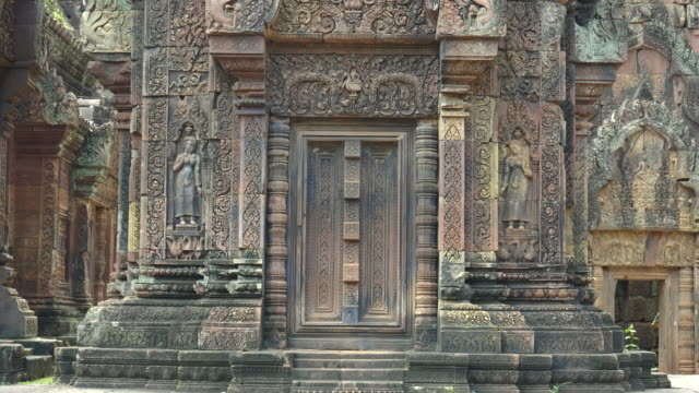 pan of two stone devata at banteay srei temple