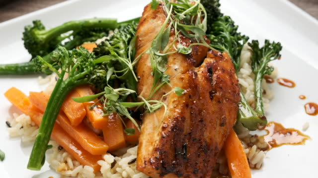 Pan Seared Salmon salmon cooked in soy glaze served with grilled vegetables and wild rice cooking pan stock videos & royalty-free footage