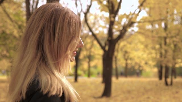 Pan Shot Camera Movement Around Happy Pretty Woman Outdoor Autumn Park 4k video