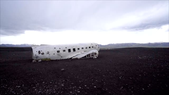 Pan shot of Airplane crashed on beach Iceland, DC3 navy plane video