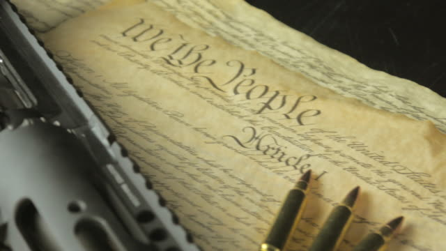 Pan Shot of an Assault Rifle on top of the United States Constitution video