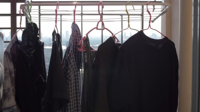 Pan shot of drying clothes in the sun Pan shot of drying clothes in the sun coathanger stock videos & royalty-free footage