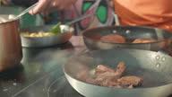 istock Pan tossing meat 1326315842