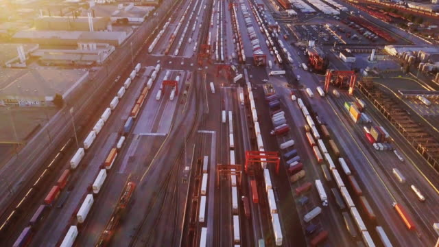 Pan Up from Intermodal Rail Yard to Downtown LA Skyline - Aerial - video