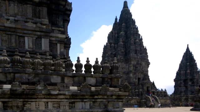 HD pan up on Prambanan Temple historical site ending on sky video